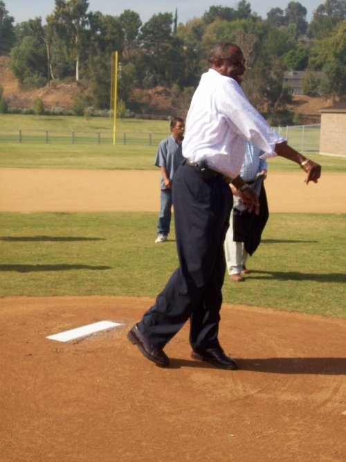 Dusty Baker throwing a pitch at the new ball diamond named in his honor.