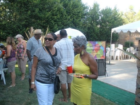Hostess Sheri Cox welcoming a  guest to the Grown Folks Soiree